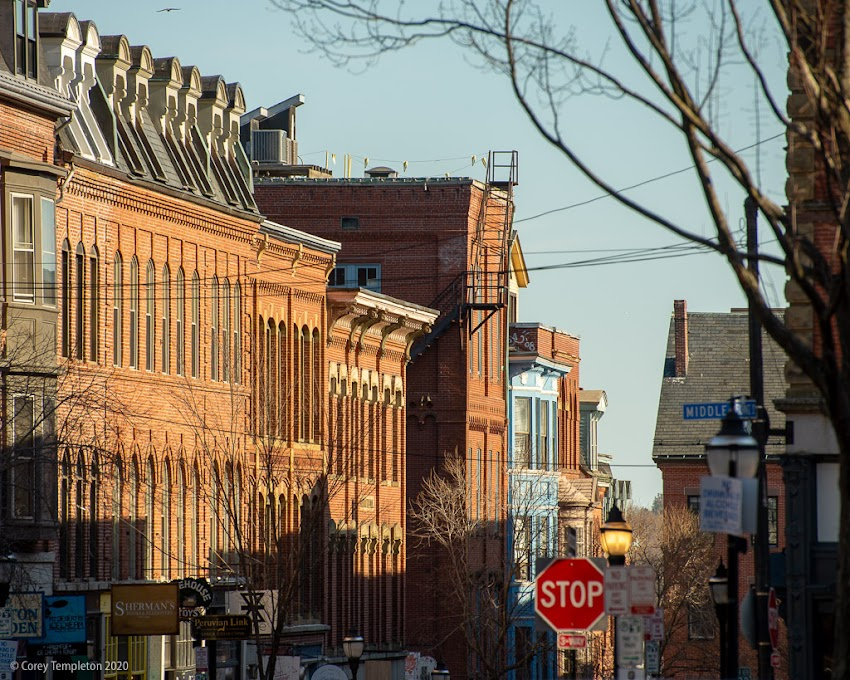 Portland, Maine USA March 2020 photo by Corey Templeton. Buildings on the east side of Exchange Street soaking up some good light. Old Port.