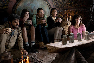 "Eugenio Derbez, Nicholas Coombe, Jeff Wahlberg, Madeleine Madden, and  Isabela Moner sit and scream in a movie still for the Dora the Explorer movie ""Dora and the Lost City of Gold"""