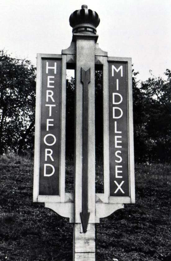 Photograph of the boundary post on the railway bank south of Hawkshead Bridge, erected by LNER 1934-5, names removed 1940