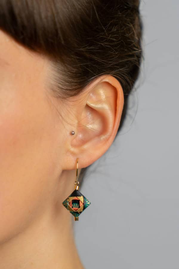 small square origami earring with golden wire on model
