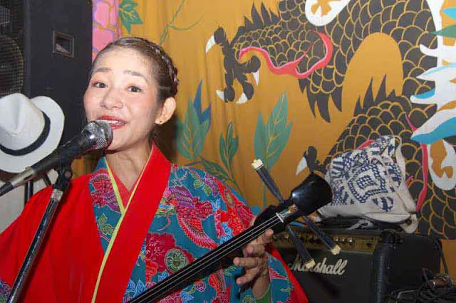 Sari, singing, playing sanshin