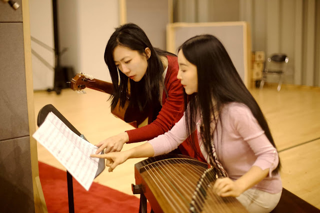 Xuefei Yang with Guzheng player Sha Yuan during recording session at NCPA