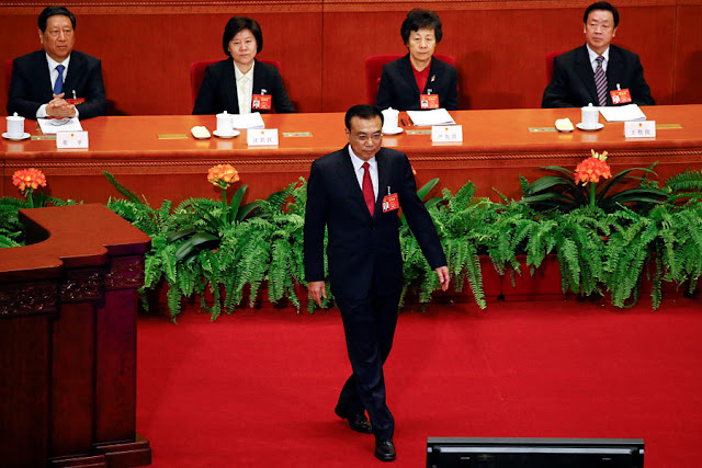 Image Attribute:  Premier Li Keqiang walks onto the stage to give a government work report during the opening session of the National People's Congress (NPC) at the Great Hall of the People in Beijing, China, March 5, 2017. REUTERS/Damir Sagolj