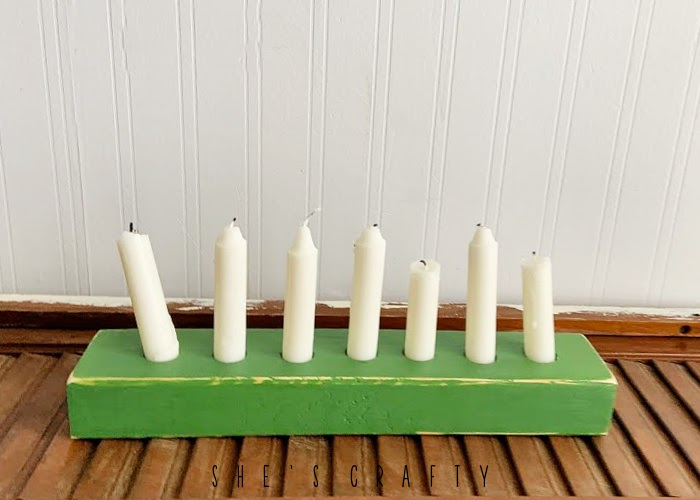 Green painted wooden candle holder