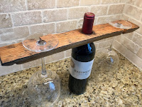 https://www.etsy.com/listing/646702963/wine-barrel-stave-bottle-glass-holder?ref=shop_home_active_1