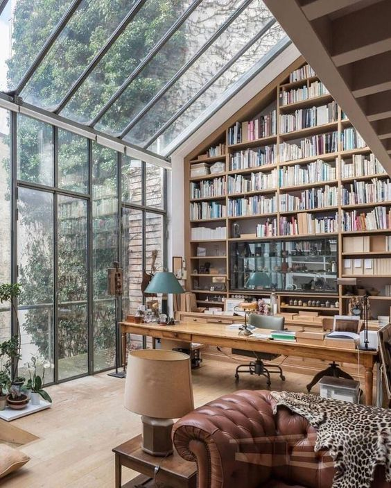 Beautiful home office with books and windows. - CozyPlaces