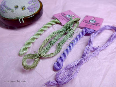 Hand dyed threads used on embroidered Lorna Bateman Lavender and Bees pincushion compared with threads in newly purchased coordinating scissors keeper.