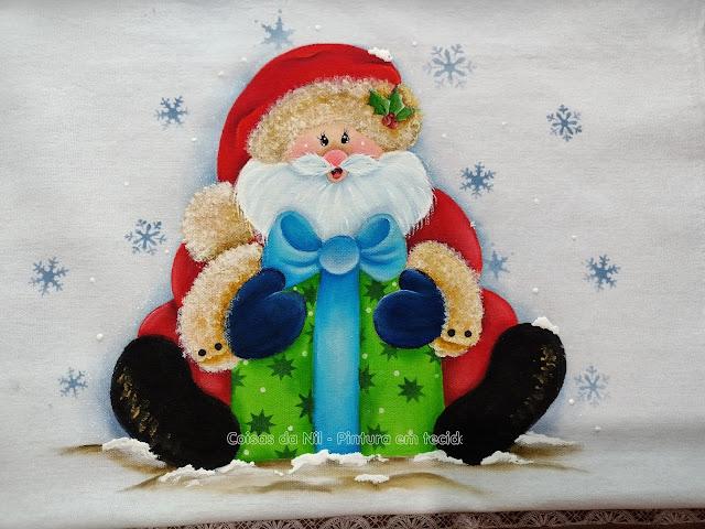 pintura de natal papai noel sentado com presente