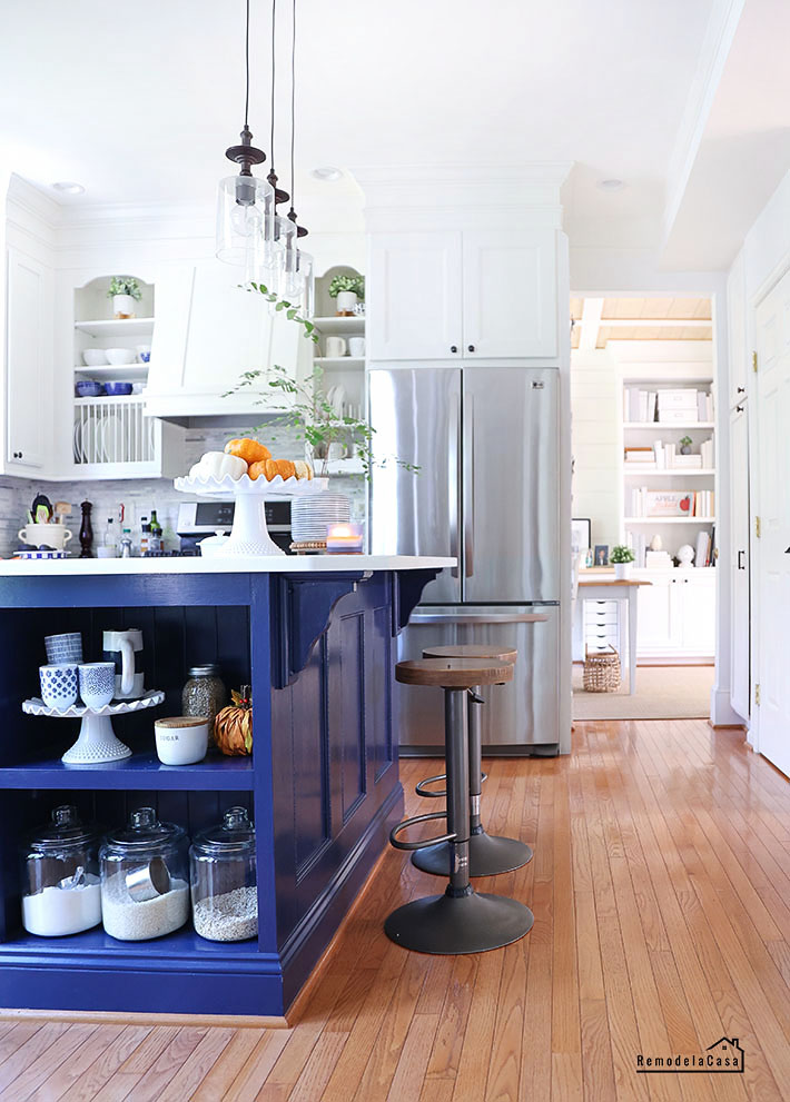 white and blue kitchen with orange accents