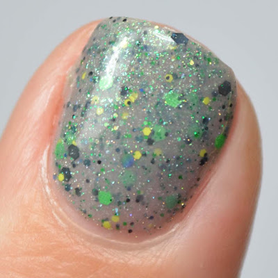 grey nail polish with green glitter swatch