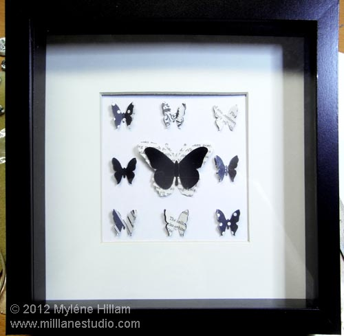 Black and white die cut butterflies mounted in a shadow box