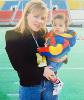 Picture of Holly Rowe carrying her son