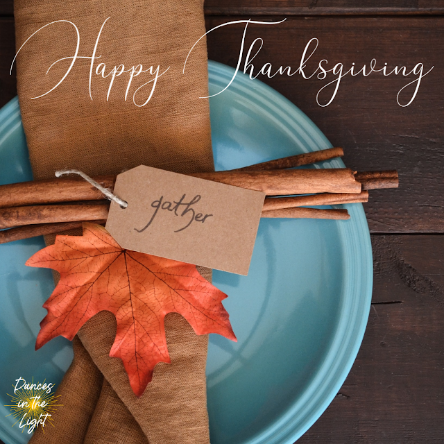 Happy Thanksgiving placesetting with napkin, cinnamon sticks