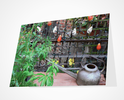 This screen-shot features a Halloween card which has an image imprinted on it. The picture was taken in my garden when decorated for Halloween. It shows Halloween-themed outdoor lights hanging on a wooden trellis. It can be purchased via Fine Art America @ https://fineartamerica.com/featured/halloween-in-the-garden-patricia-youngquist.html?product=greeting-card