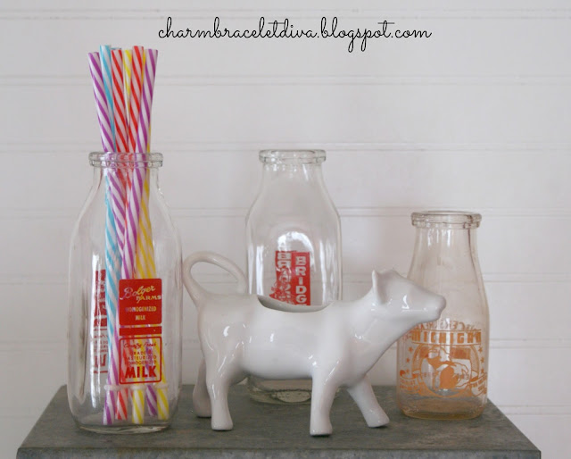 Vintage milk bottles and cow creamer