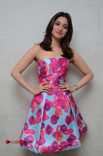 Actress Tamanna Latest Images in Floral Short Dress at Okkadochadu Movie Promotions  0070.JPG