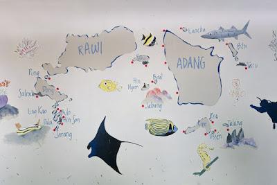 Foto van een plattegrond van de duikplaatsen rondom Koh Lipe