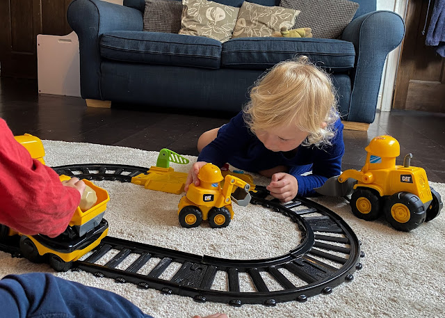 Two children playing with the Junior Crew train set and Construction Buddy