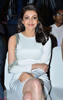 Beautiful Smiling Kajal Aggarwal in Creamy White Gown at MLA Telugu Movie Success Meet ~ .com Exclusive Pics 025.jpg