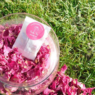 Bright pink confetti made from dried peony petals