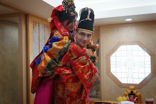 Traditional Korean wedding ceremony at wedding hall - piggy back ride