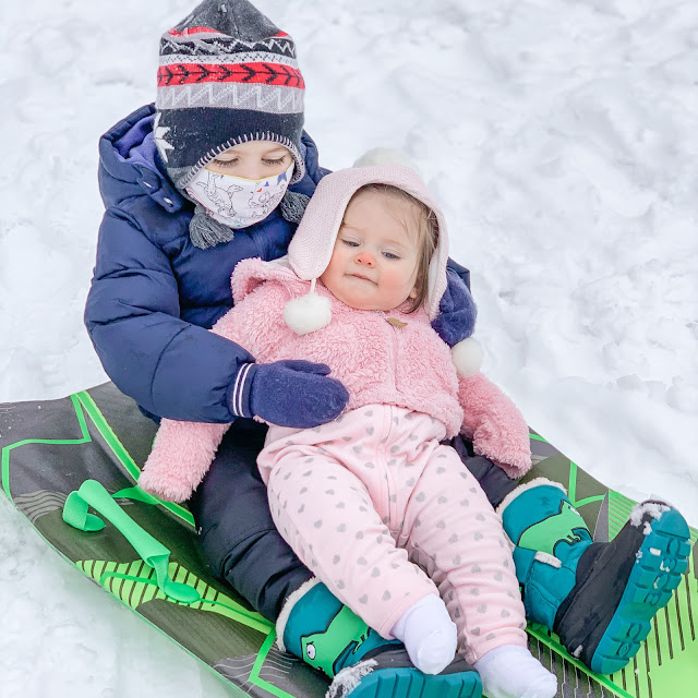 Brother and sister sledding
