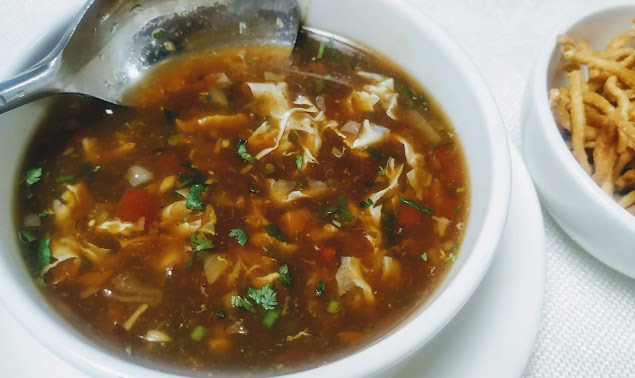 Serving chicken manchow soup with fried noodles for chicken manchow soup recipe
