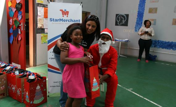 Girl receiving her gift from Santa Claus - Winning Form