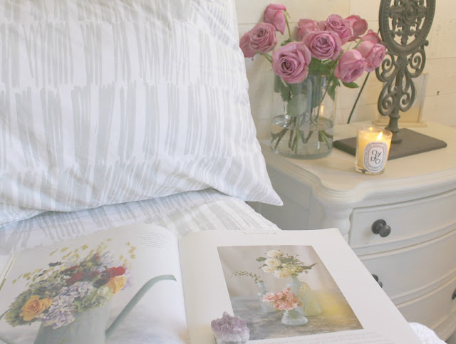 Brushstrokes light silver sheets on bed and Fresh book by Sybil Sylvester