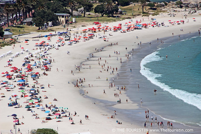 Travel South Africa. Cape Town For Beginners. Camps Bay Beach. Tourists. Sun umbrellas