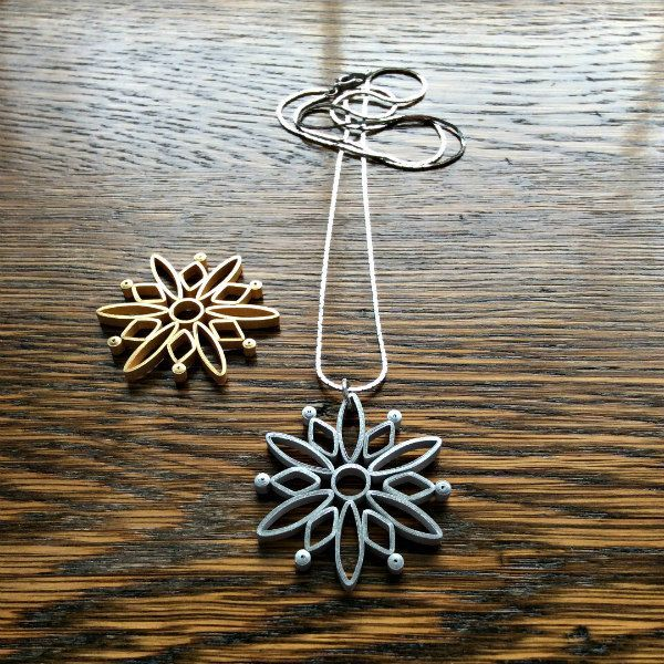 two metallic quilled snowflakes and silver necklace chain