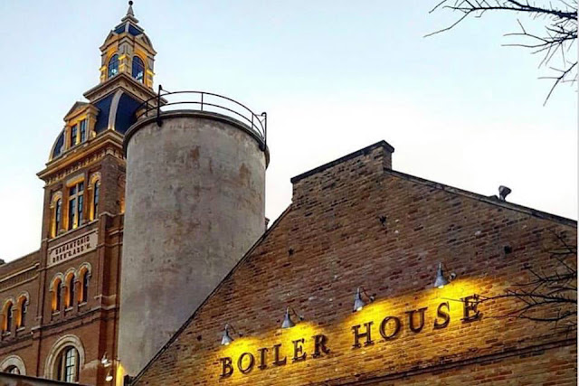 tower, silo, and lit up sign of the Boiler House