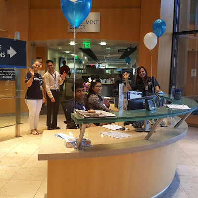 Photo of Rio Salado staff at front welcome desk.