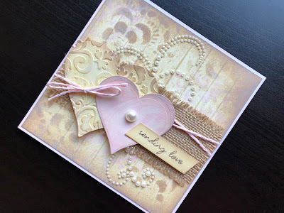 Hand made Valentine card with stamped, inked background, die cut hearts, hessian ribbon and pearls