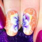 http://nails-arcenciel.blogspot.fr/2015/04/tuto-video-nail-art-fleur-au-one-stroke.html