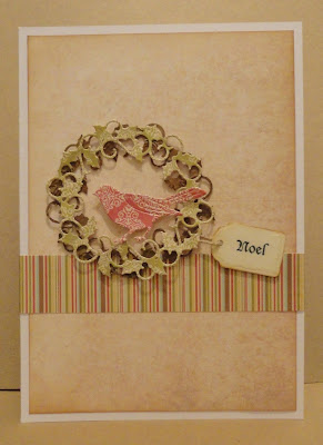 Christmas card with holly wreath, bird and Noel tag