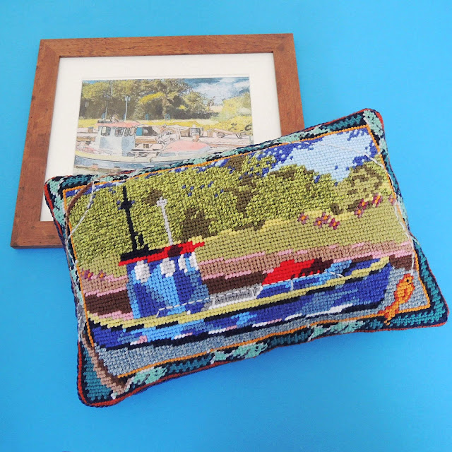 Needlepoint cushin and watercolour of a river fishing boat on a sunny day