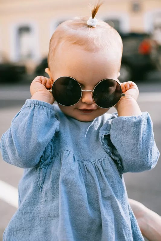 crazy baby with sunglass look