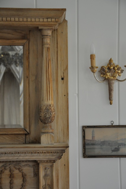 Detail of stripped wood on antique fireplace mantel by Giannetti Home