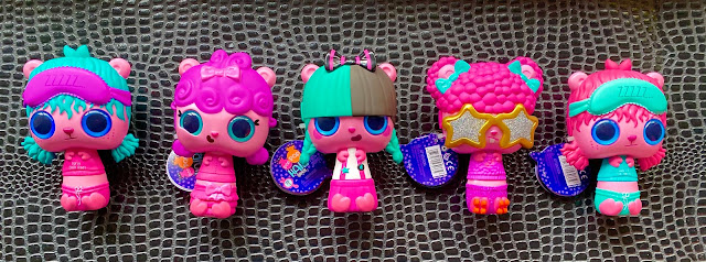 5 pop pop hair surprise toys in a row ready to review. They have big pink heads with large blue eyes and thin bodies