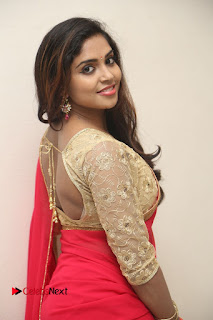 Actress Karunya Chowdary Pictures in Red Saree at Neerajanam Audio Launch  0056