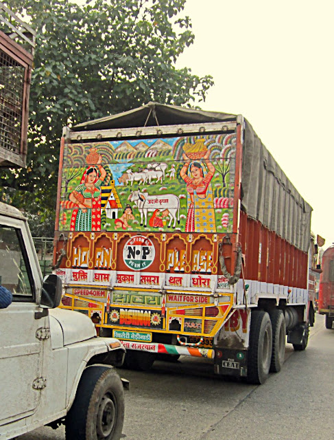 painted scene on back of truck in India