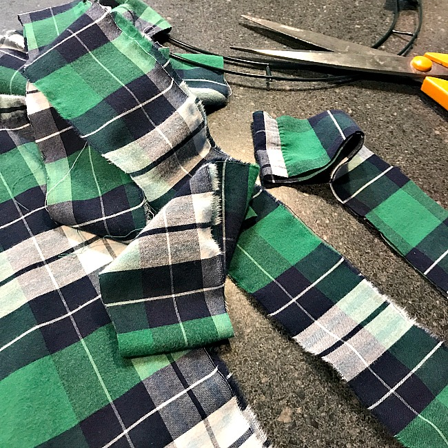 scissors and strips of green plaid