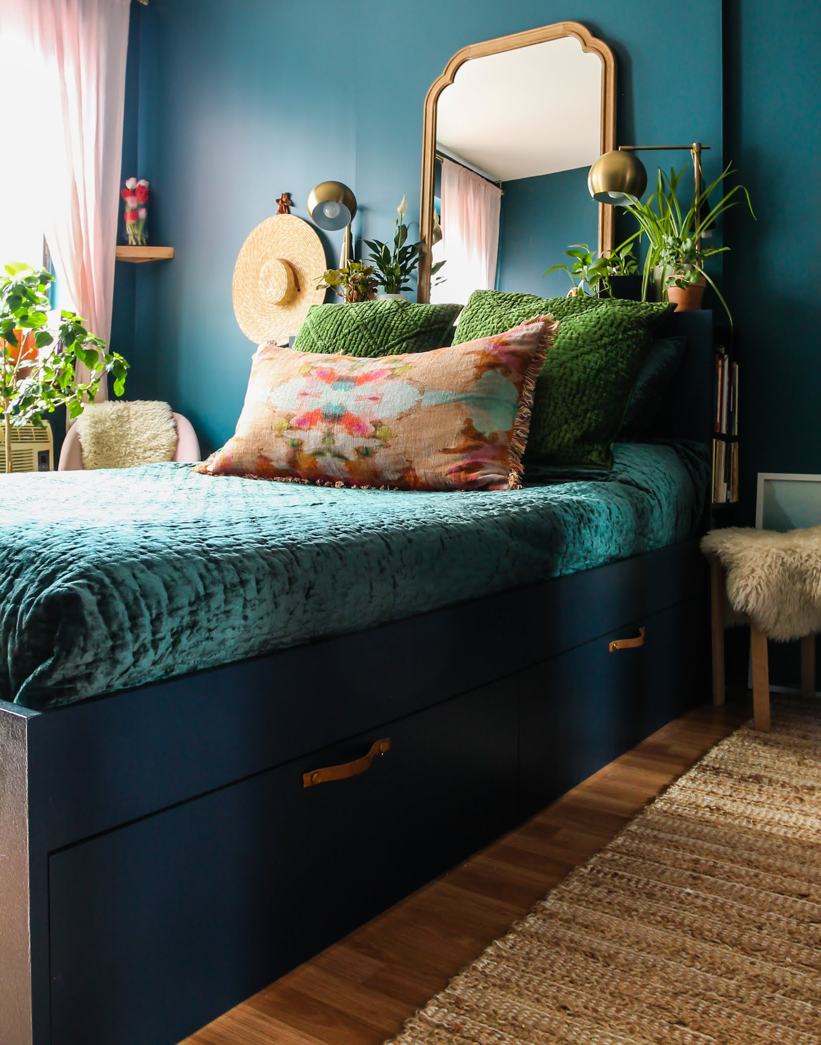 jeweltone bedroom // ikea hack // Brimnes bed handle upgrade // blue and green bedroom // blue and green decor // jeweltone decor // easy ikea hacks // colorful bedrooms // colorful boho bedrooms // teal bedroom // navy bedroom decor // Clare goodnight moon // clare deep dive // bedroom with plants // ikea hacks // Annie selke bedding // Annie selke kenly