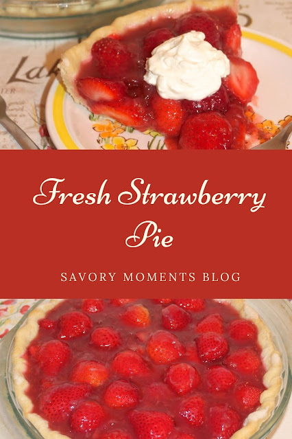Fresh strawberry pie slice and in a pie plate.