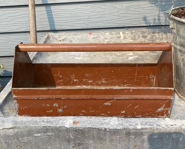 Photo of a vintage metal toolbox.