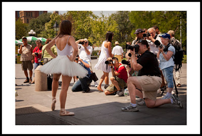 a photograph of a ballerina and several photographers in a park in new york