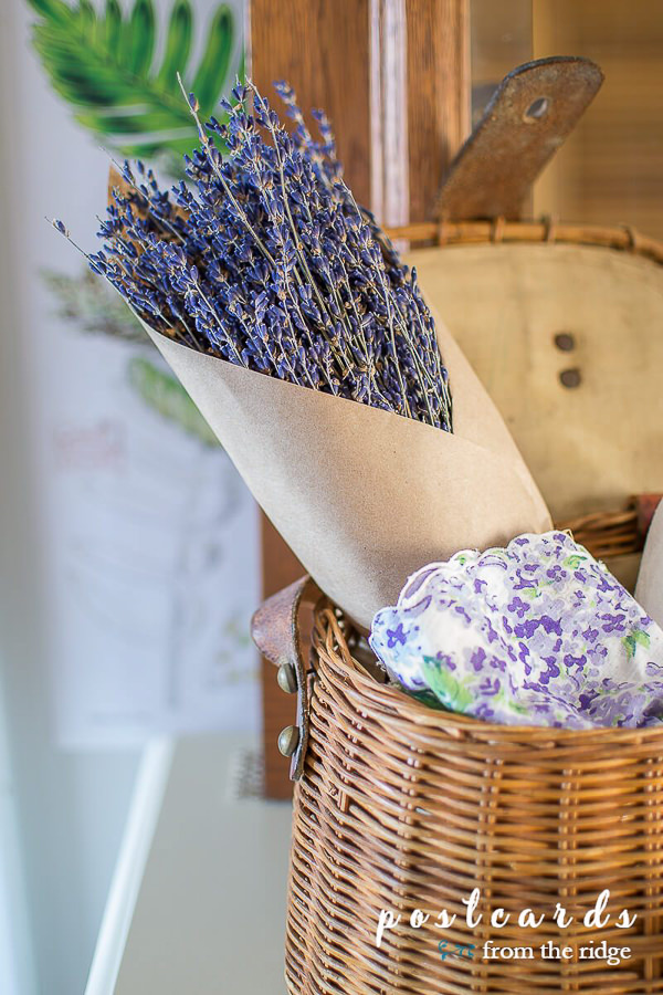 dried French lavender with a vintage handkerchief in a vintage fishing creel