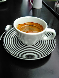 Cafe table, where writers work best, stripy espresso cup