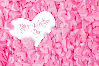 Heart with happy Valentines day with pink rose petals